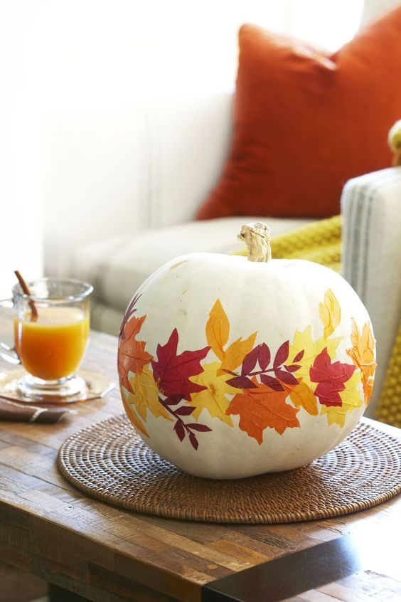 a white pumpkin with bright fall leaves decoupaged is a cool idea for the fall and will last long if you take a faux pumpkin