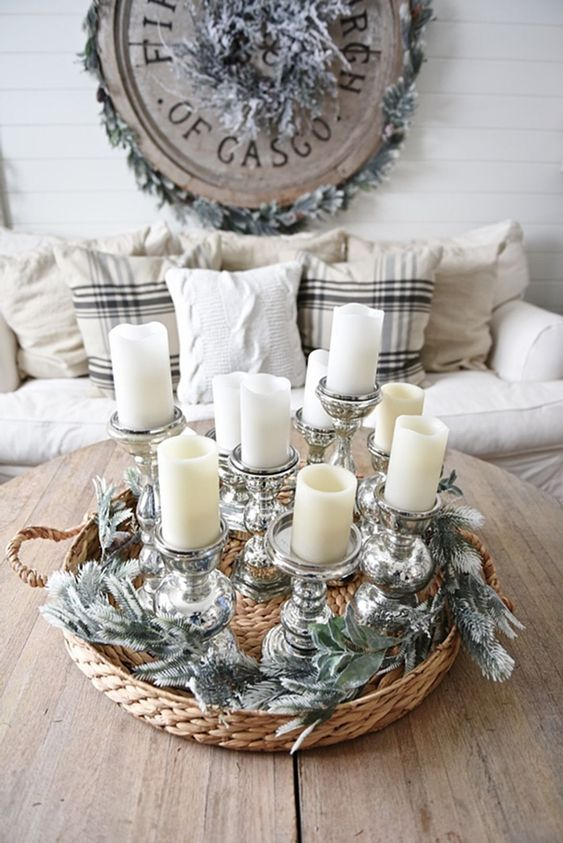 an arrangement of pillar candles in elegant metallic candle holders is a very chic and cool decoration for a winter space