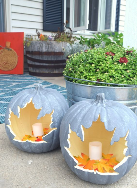 candle lanterns carved of faux pumpkins with leaves inside are great for decorating your home both indoors and outdoors