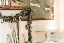 evergreens, pinecones, branches, wood and lots of lights make this little nook very cozy and very welcoming