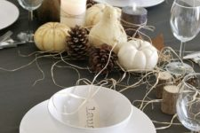 gourds and pumpkins, hay and pinecones, tree stumps and simple white porcelain for a modern Thanksgiving tablescape