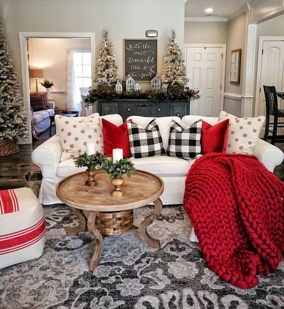 red pillows and a blanket, plaid pillows give the living room a holiday spirit and make it lively