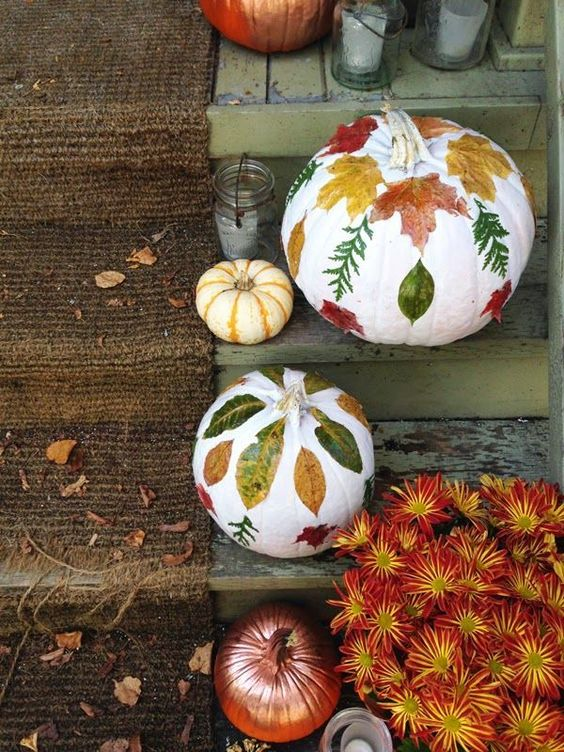 white pumpkins with fall leaf decoupage and a bronze one will decorate your steps easily