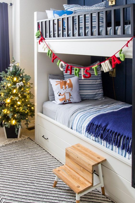 a colorful letter banner and a Christmas tree with lights will bring a cool holiday feel to the space