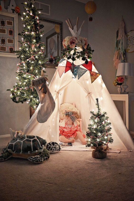a couple of Christmas trees with lights and beads will create a lovely holiday mood in the kids' room