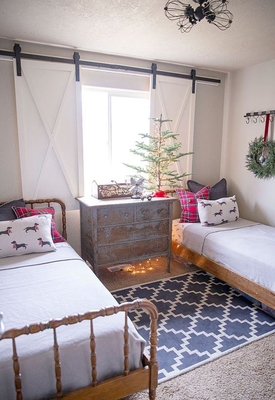 a non-decorated Christmas tree, plaid pillows and some lights for a slight holiday touch in your kids' room
