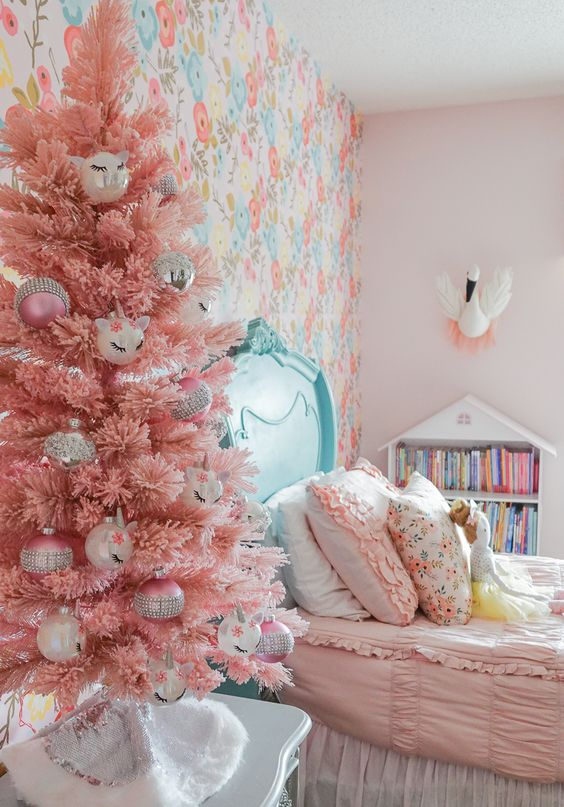 a pink Christmas tree with various ornaments will easily bring a holiday feel to your kid's room and will make it amazing