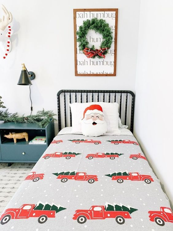 a wreath artwork, some faux fir garlands, bright printed bedding for creating a holiday feel in the space easily