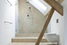 a contemporary attic bathroom with wooden beams, a neutral shower space and warm tiles on the floor