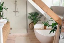 a minimalist bathroom with a wooden beam, a large window, a tub and a shower space and a floating wooden vanity