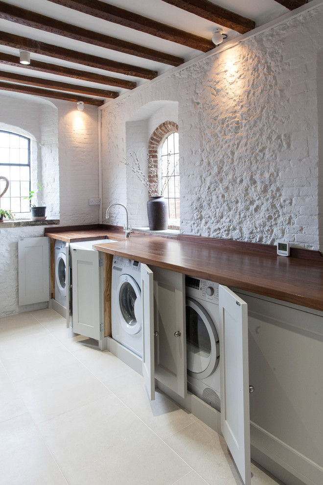 Covered washers and dryers won't spoil farmhouse-style kitchen design.