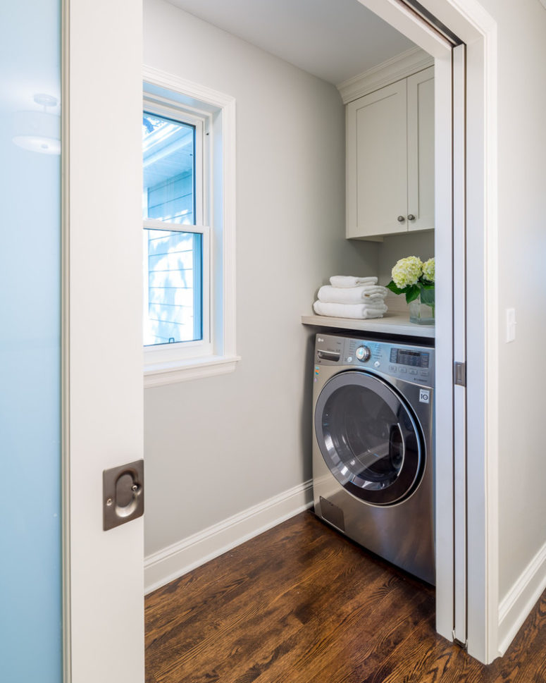 Turn an awkward corner into a tiny laundry room. (Sicora Design/Build)