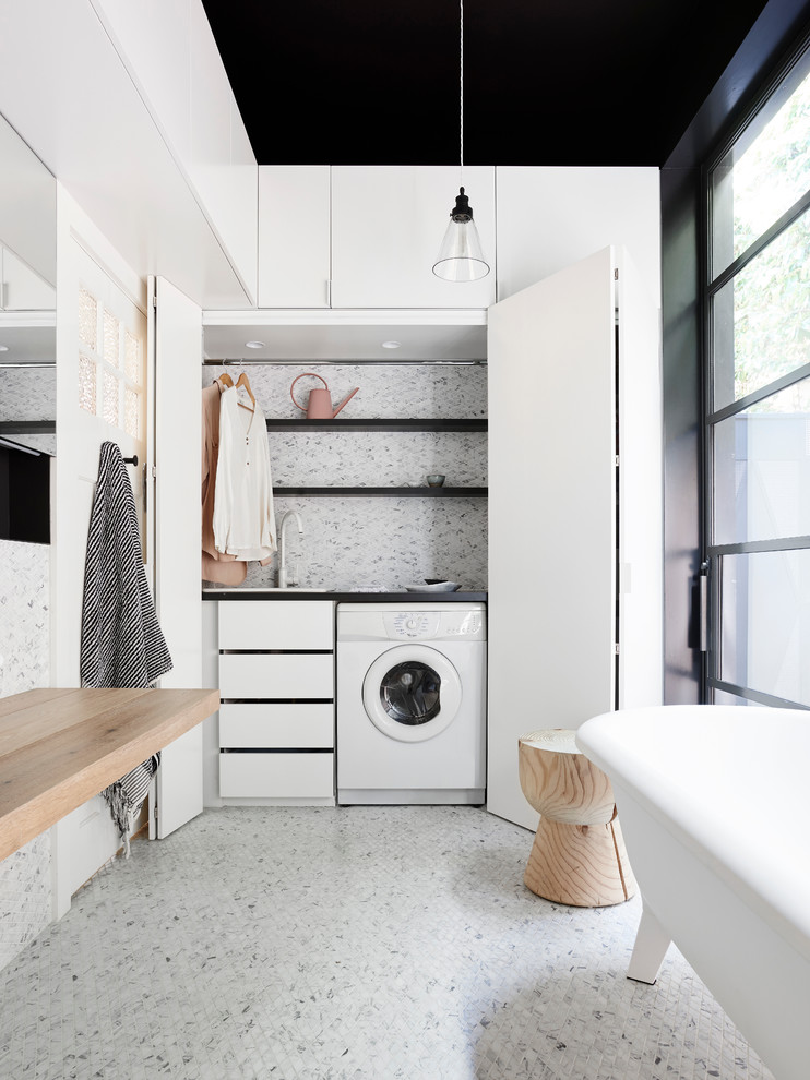 This bathroom and laundry combo is a great example of how you can turn a stylish space into a practical one. (NORTHBOURNE Architecture + Design)