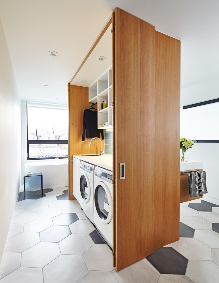 A thoughtful cabinet could become a room divider and a laundry space in one. (post Architecture)