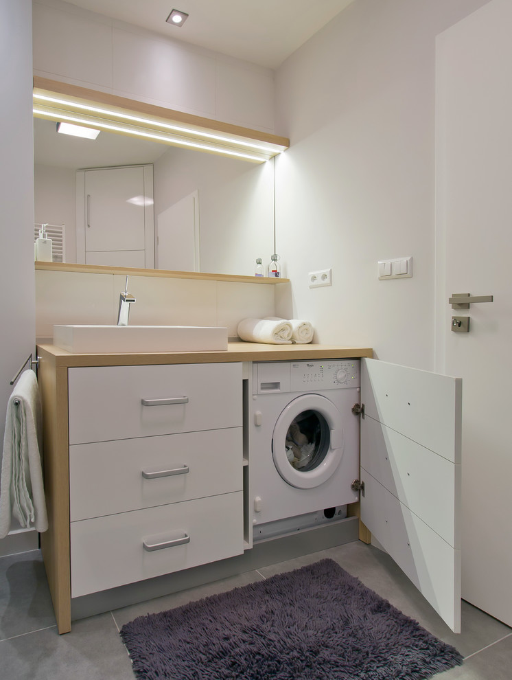 You can fit a washer-dryer combo even in a tiny bathroom. (Goldfish-Interiors)