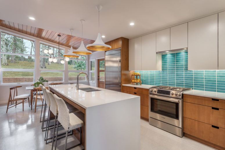 a white and stained mid-century modern kitchen with a white kitchen island and a turquoise tile backsplash  (CarsonSpeer Builders)
