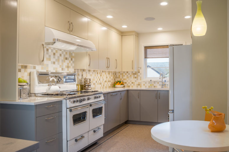 a white and grey mid-century modern kitchen with a mosaic tile backsplash and much light  (Smithcraft Fine Construction)