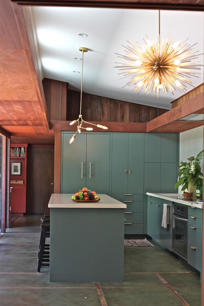 a forest green mid-century modern kitchen with white countertops, a sunburst chandelier and a tile floor  (cocoon home design)