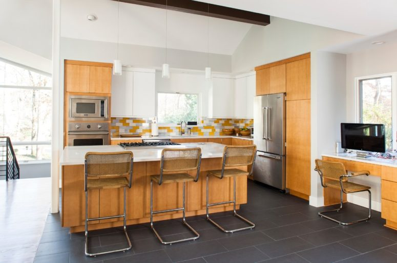 a light yellow mid-century modern kitchen with touches of white and wire stools  (Alair Homes Decatur)