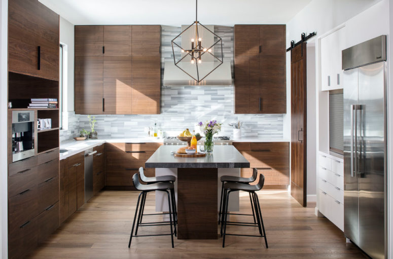 a rich-stained mid-century modern kitchen with a grey tile backsplash, a large kitchen island with an eating zone  (KW Designs)