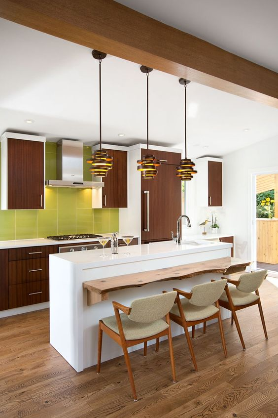 a 60s inspired kitchen with brown cabinets, a white kitchen island and a green tile backsplash