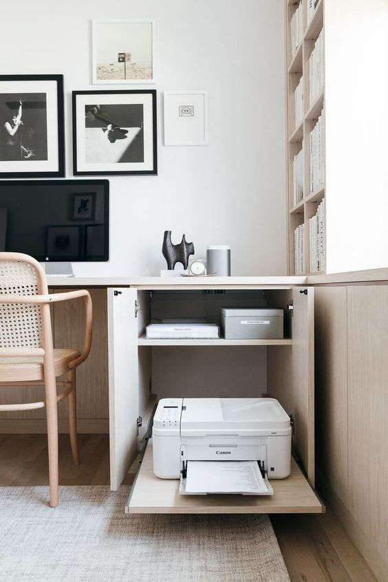a cabinet with a hidden printed is a cool idea to organize keeping your space minimalist and clean