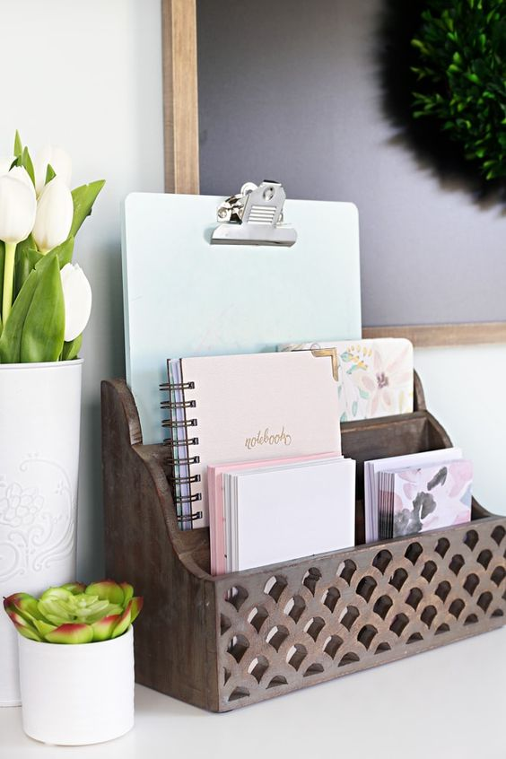 a carved wooden holder for documents and notebooks is a cool piece to add a rustic touch and organize your office