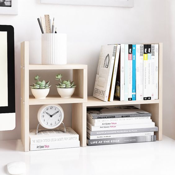 a contemporary wooden office organizer for books, magazines, pencils, pens and mini pots with succulents