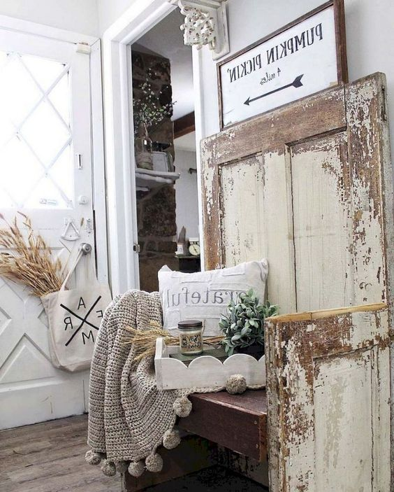 a farmhouse shabby chic entry with signs, a wooden bench, wheat, greenery and a knit blanket