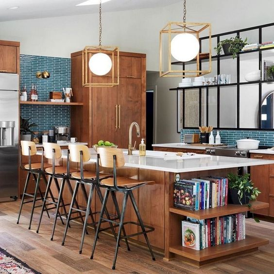 a mid-century modern kitchen with rich-stained cabinets and a kitchen island, a turquoise tile backsplash and geometric pendant lamps