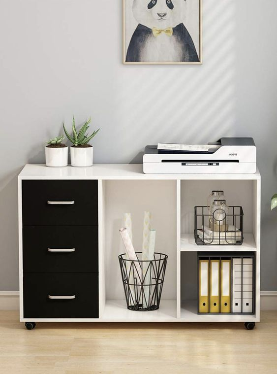 a modern cabinet, partly opened and with drawers is a comfortable piece for storage and it looks trendy