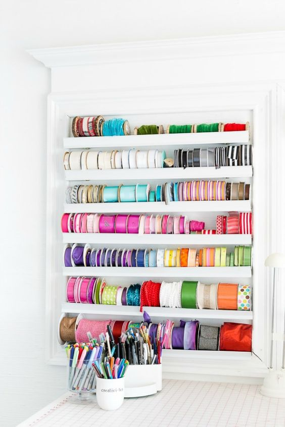 a storage unit with ledges is ideal for storing colorful ribbons and washi tape