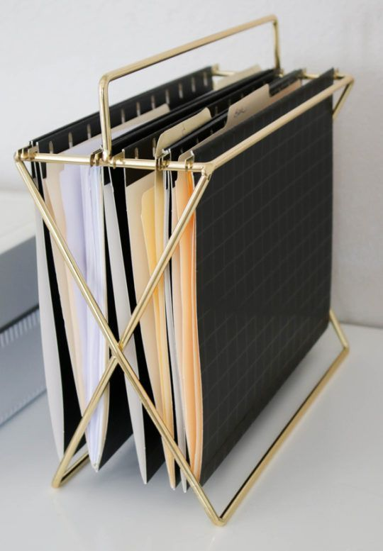 a stylish gold file holder can be placed both on the desk and on the floor and is great for storage