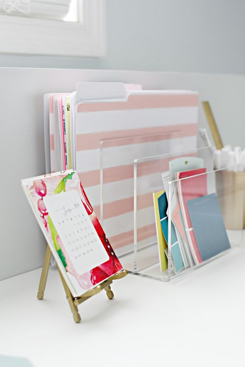 an acrylic file or document organizer is an airy and light idea to bring your papers in order