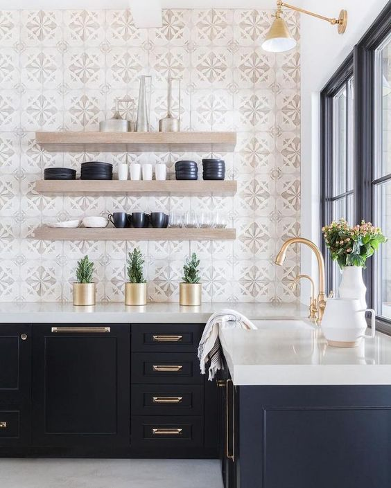 an elegant mid-century modern kitchen with mosaic tiles, navy cabinets and a white countertop