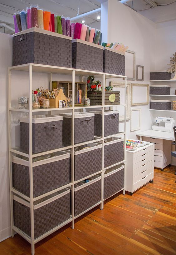 an open shelving unit done with simple boxes is a perfect idea that is easy to realize