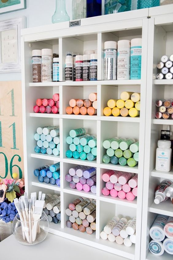 an open storage unit with shelves is great for storing paints or markers