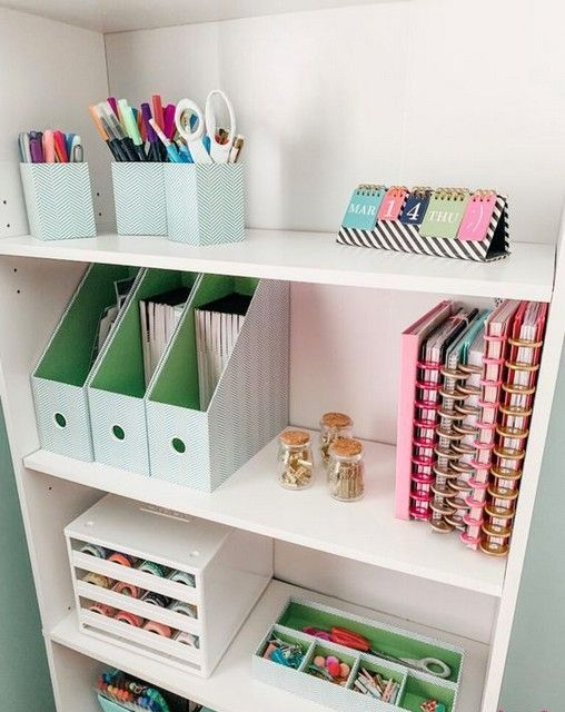 an open storage unit with various holders and organizers is a perfect for piece for every kind of office stuff