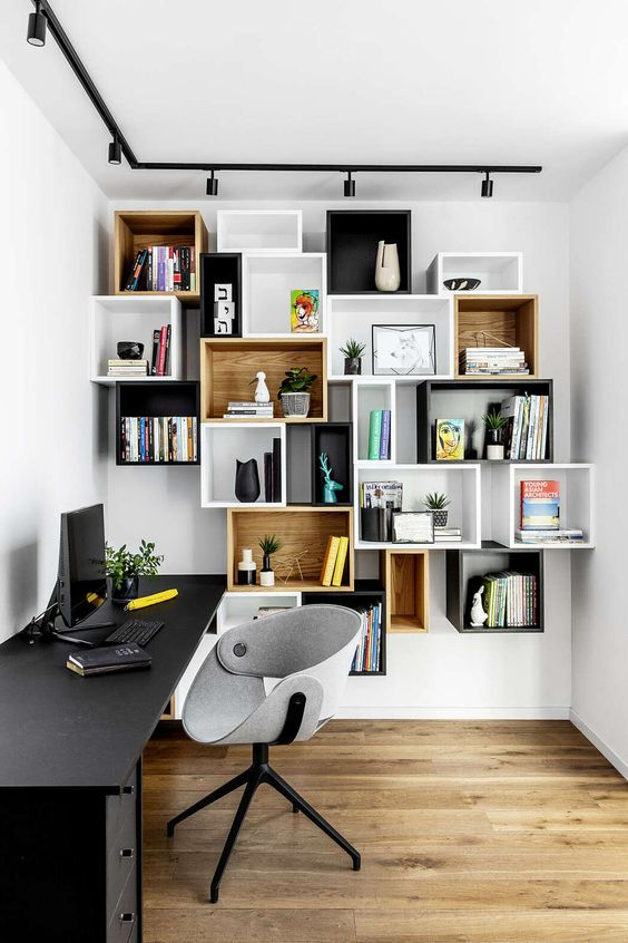 mismatching box wall-mounted shelving units double as decoration in a home office