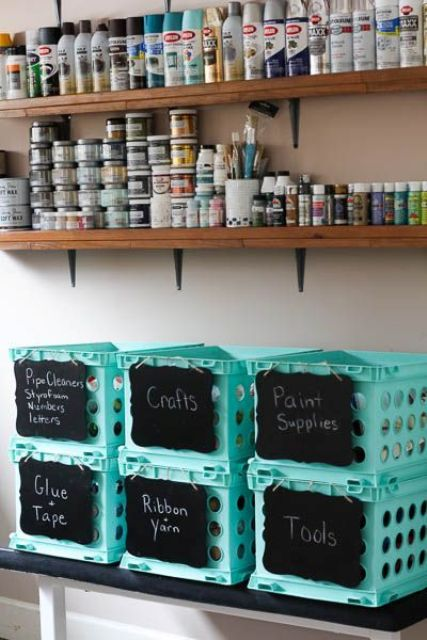 open shelving and blue plastic boxes with chalkboard labels