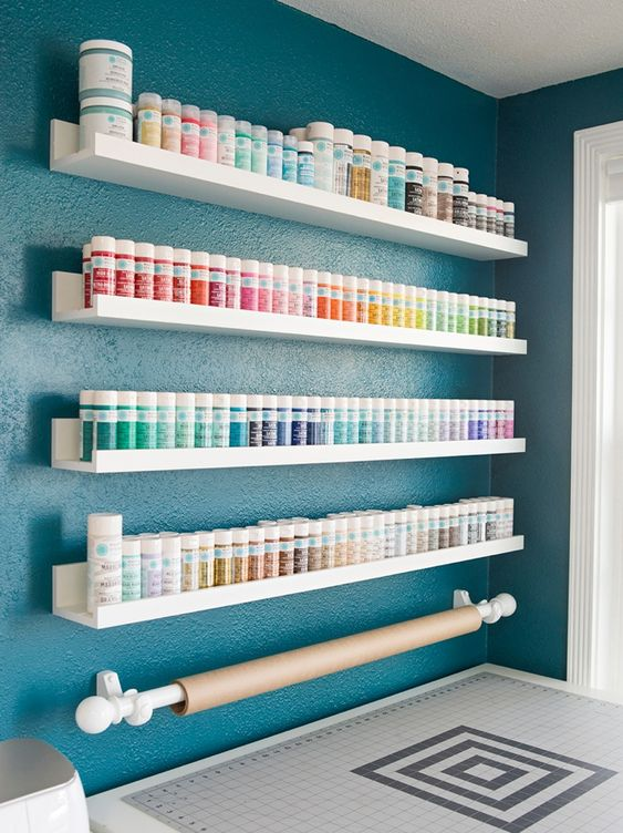 simple IKEA ledges can store all your paints easil and you may organize them by colors
