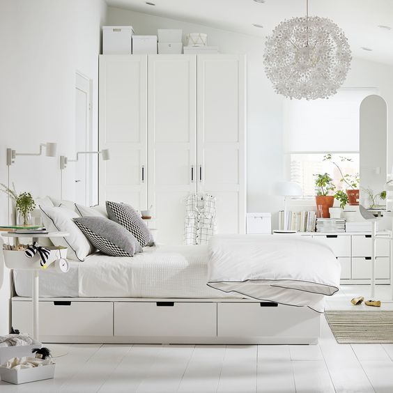 IKEA Nordli bed is a classic piece with storage drawers and a headboard that also features shelves for various units
