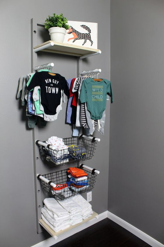 a baby clothes rack with holders, wire baskets and opne shelves is a cool idea to go for