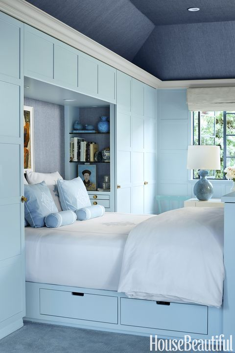 a built-in powder blue bed with a couple of visible drawers is a cool storage idea for a small bedroom in any style