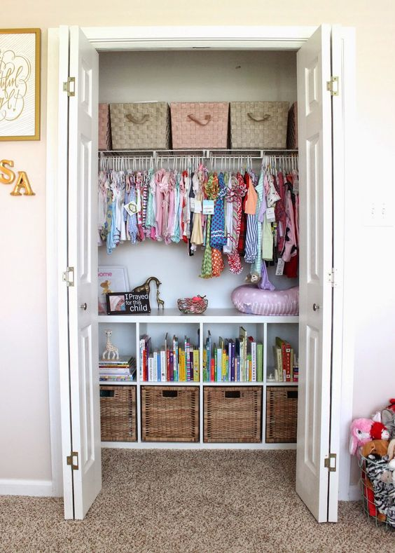 a closet done with baskets and woven boxes plus clothes hangers is a stylisha nd very accurate idea