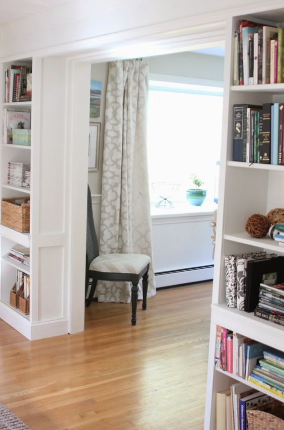 a doorway surrounded with open shelves for book and accessory storage and display is a very cool and fresh idea to rock