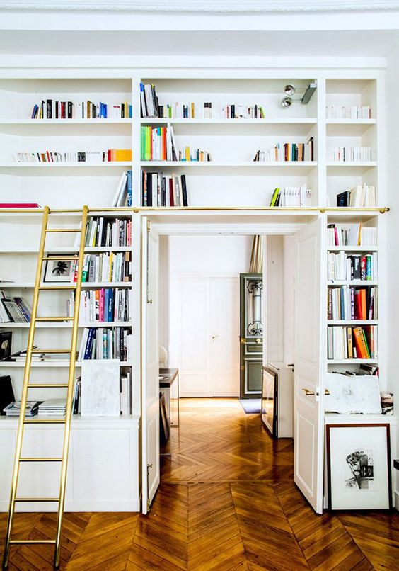 a doorway with open shelves, a ladder to get books is a lovely idea to create a lightweight bookcase that won't take much space