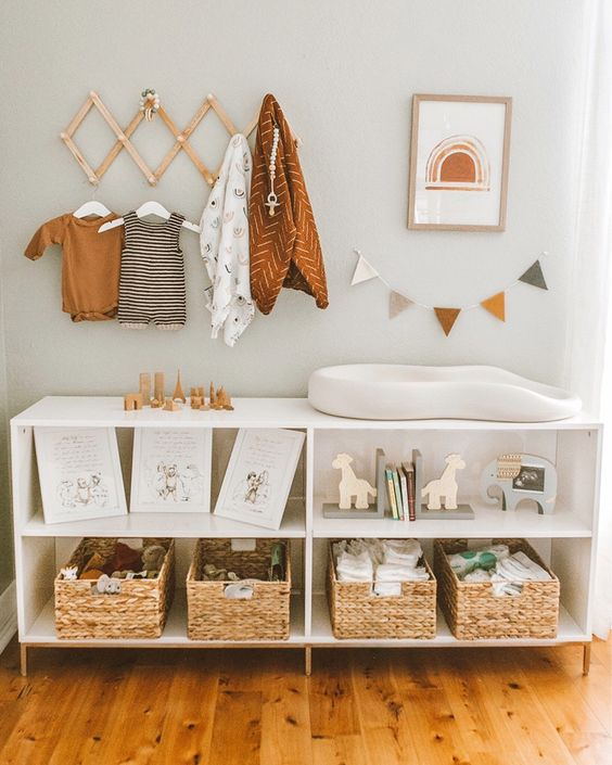 a large changing table with woven boxes and open storage compartments for toys and other stuff