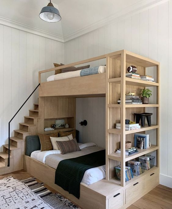 a light stained bunk bed with open shelving and drawers for storage is a cool modern solution for a small kids' room