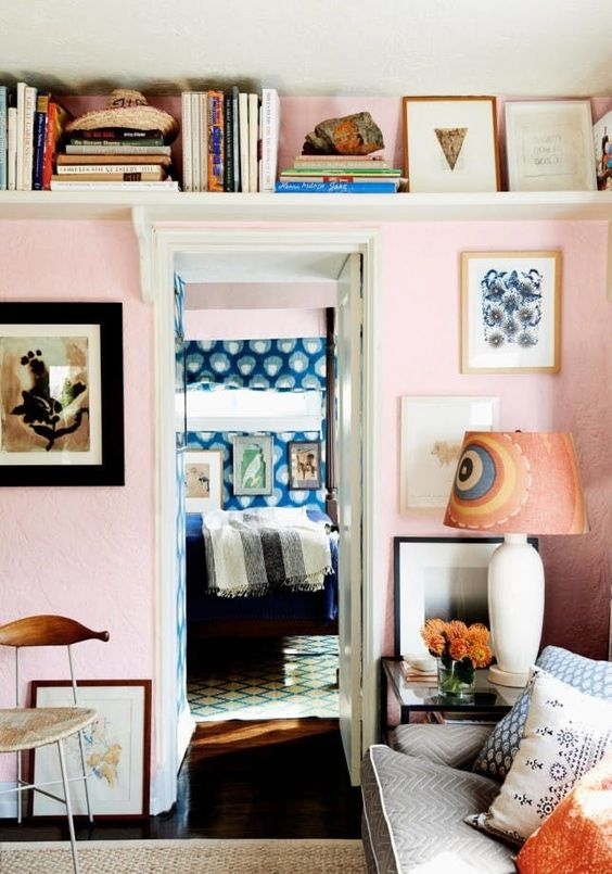 a long shelf over the doorway is a cool idea to store some things and display them and to avoid cluttering the room at the same time